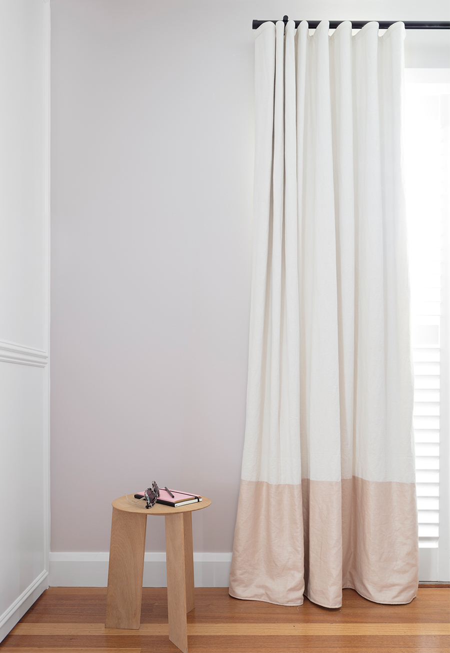 Pink & white curtains with modern wooden side table