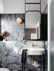 A luxurious grey marble and stone bathroom
