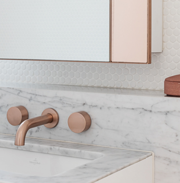 Pink gold mirror and tap