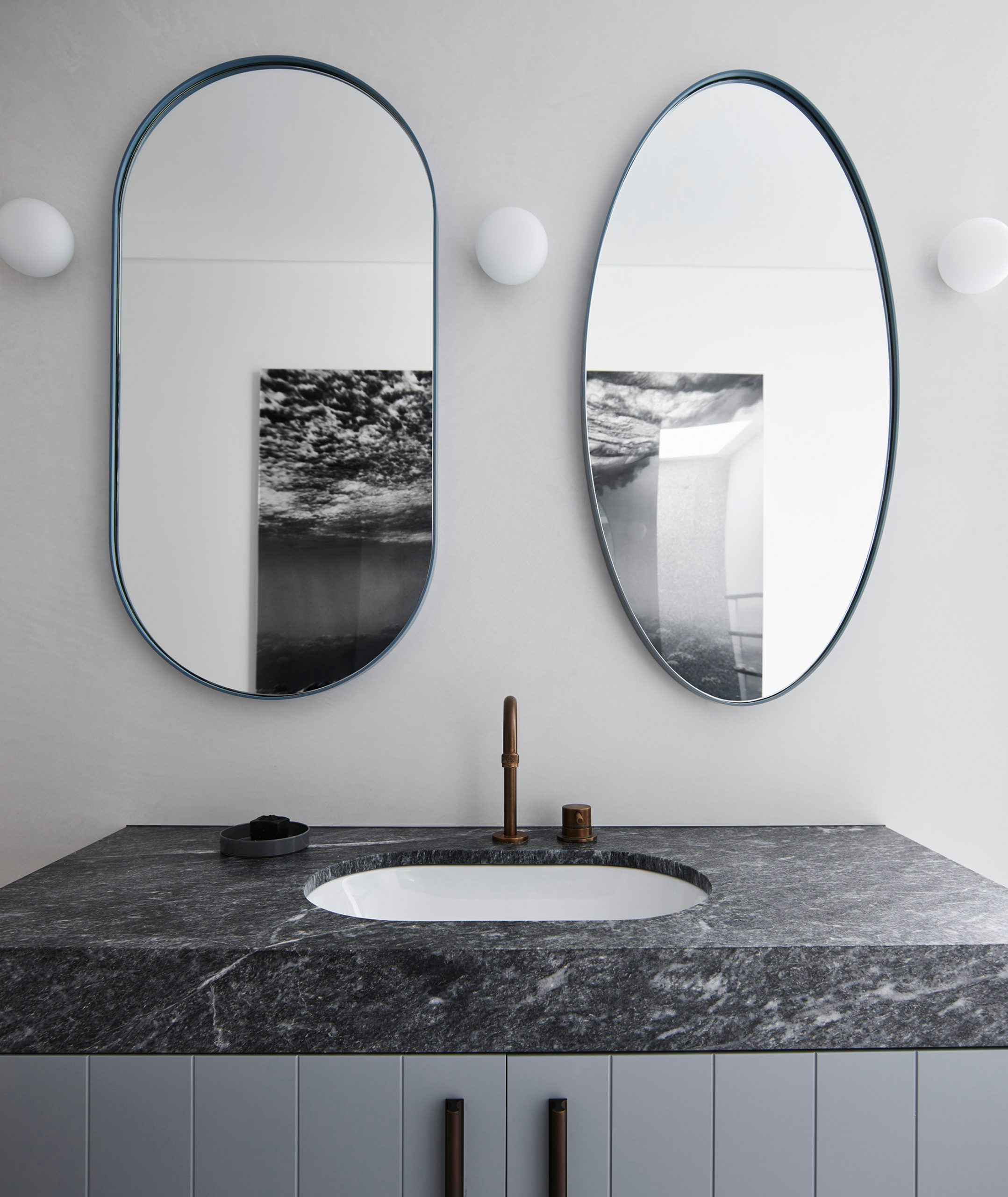 Black &grey bathroom sink & mirrors