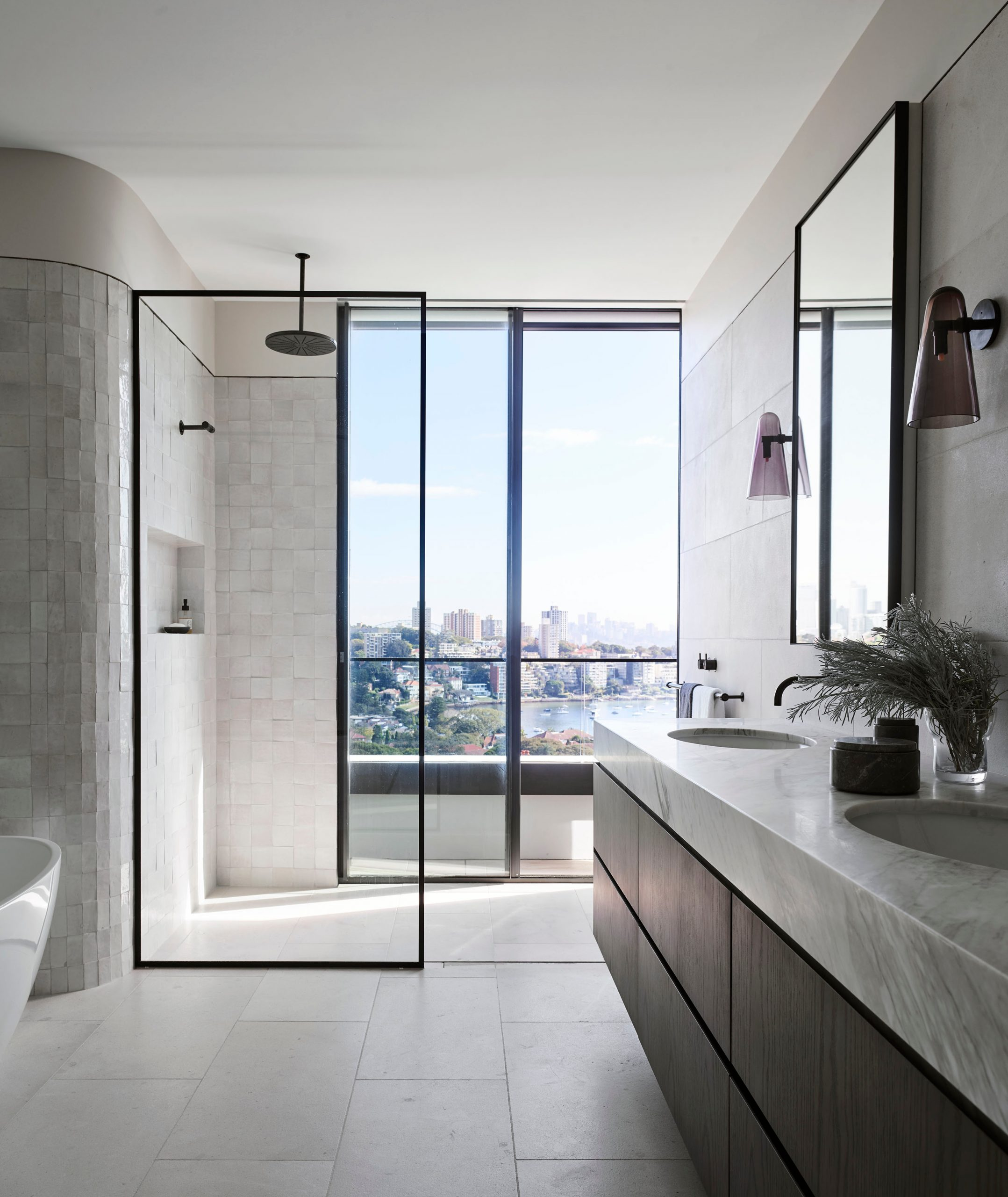 Shower with city skyline view